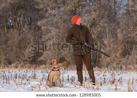 Hunter with dog #128985005