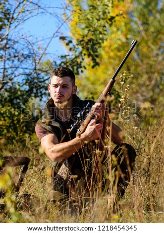 Hunter with rifle ready to hunting nature background. Hunting skills and strategy. Hunting strategy or method for locating targeting and killing targeted animal. Man hunting wait for animal.