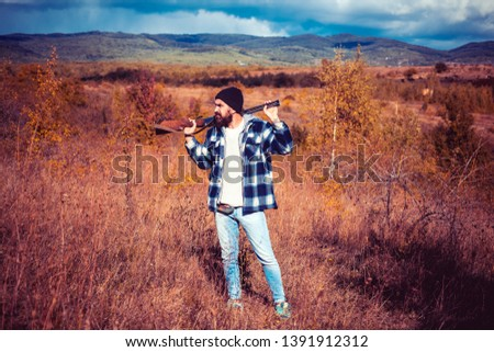 Hunter with shotgun gun on hunt. Autunm hunting. Closed and open hunting season. Hunting Gear and Hunting Clothing. Big game #1391912312
