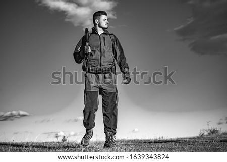 Hunter with shotgun gun on hunt. Hunter in the hunting season. Hunting period. Male with a gun. Hunter with hunting gun and hunting form to hunt