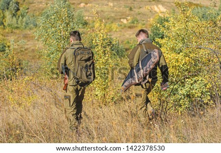 Hunters gamekeepers looking for animal or bird. Hunter friend enjoy leisure in field. Hobby for real men concept. Hunters with rifles in nature environment. Hunting with friends hobby leisure.