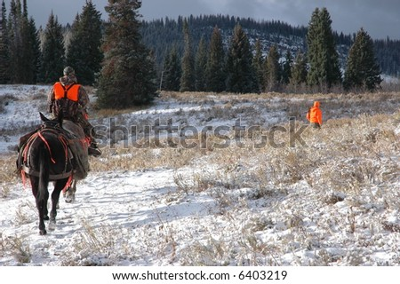 Hunters in Mountain Meadow with Mules