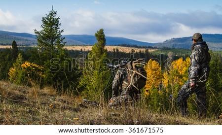 Hunters on a Mountain Ridge Stockfoto ©
