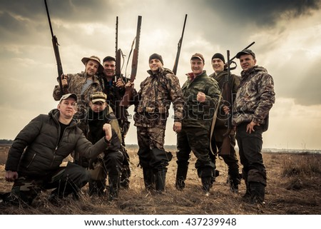 Shutterstock Hunters standing together against sunrise sky in rural field during hunting season. Concept for teamwork.