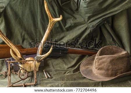 hunting carbine  deer antlers ...