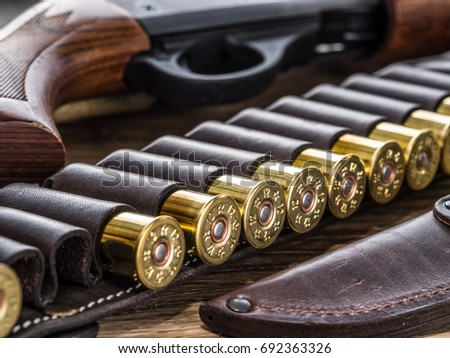 Gun and a knife on a wooden table Images and Stock Photos