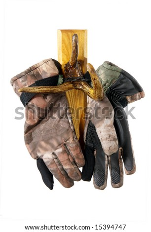 Hunting gloves are hanging of the moose horn