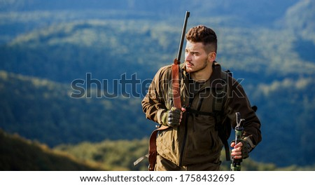 Hunting period. Shooter sighting in the target. The man is on the hunt. Male with a gun. Hunter with hunting gun and hunting form to hunt. Hunt hunting rifle. Hunter man.