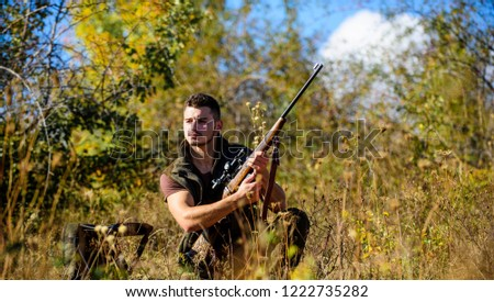 Hunting skills and strategy. Hunting strategy or method for locating targeting and killing targeted animal. Man hunting wait for animal. Hunter with rifle ready to hunting nature background.