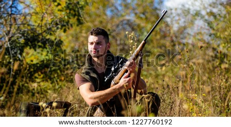 Hunting skills and strategy. Man hunting wait for animal. Hunter with rifle ready to hunting nature background. Hunting strategy or method for locating targeting and killing targeted animal.