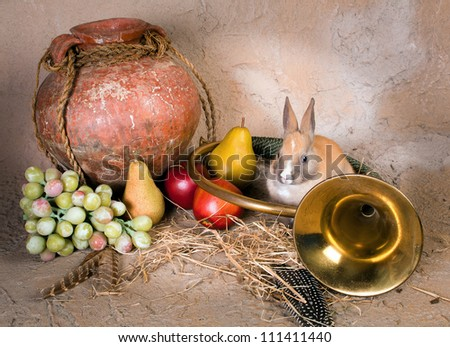 Hunting still life with a live rabbit and antique bugle horn - stock photo