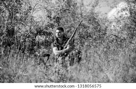 Hunting strategy or method for locating targeting and killing targeted animal. Hunting skills and strategy. Hunter with rifle ready to hunting nature background. Man hunting wait for animal.
