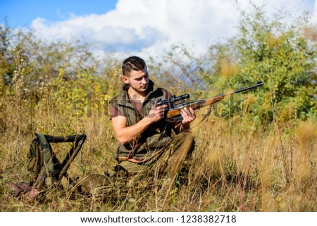 Hunting strategy or method for locating targeting and killing targeted animal. Man hunting wait for animal. Hunter with rifle ready to hunting nature background. Hunting skills and strategy.
