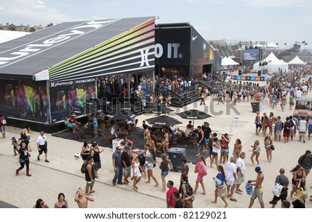 HUNTINGTON BEACH, CA - AUGUST 1: Crowds gather in the Pavilion area for the start of the US Open Surfing contest on August 1, 2011 in Huntington Beach, CA.