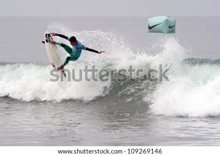 HUNTINGTON BEACH, CA - AUGUST 2: Filipe Toledo competes in the Nike US Open of Surfing in Huntington Beach, CA on August 2, 2012