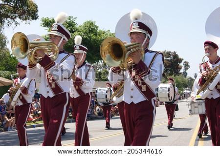 HUNTINGTON BEACH, CA - JULY 4: Marching band playing brass instruments during Huntington Beach July 4th parade