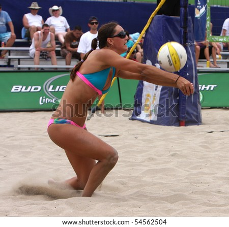 HUNTINGTON BEACH, CA - JUNE 4: Christal Morrison is digging a ball at the AVP Huntington Open pro beach volleyball tournament June 4, 2010 in Huntington Beach, CA