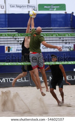 HUNTINGTON BEACH, CA - JUNE 5: Phil Dalhausser vs. Casey Patterson at the net at the AVP pro volleyball tournament June 5, 2010 in Huntington Beach, CA - stock photo