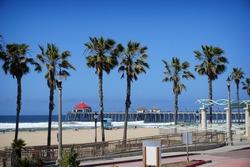 Huntington Beach pier on California coast with palm trees
