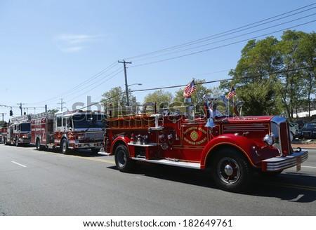 HUNTINGTON, NY - SEPTEMBER 7:1950 Mack fire truck from Huntington Manor Fire Department leading firetrucks parade in Huntington on September 7, 2013. Huntington Manor Fire Department organized in 1903