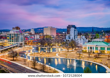 Huntsville, Alabama, USA park and downtown cityscape at twilight.