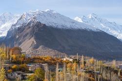 Hunza valley in autumn season surrounded by Karakoram mountain range in Gilgit Baltistan, Pakistan, Asia