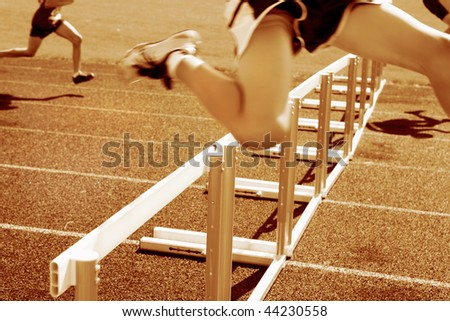 Hurdle race, motion blur on runners