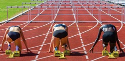 hurdle runners in start position