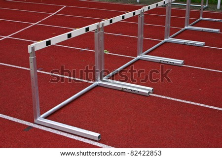 Hurdles and red running tracks in a stadion