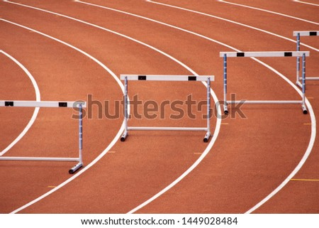 Hurdles on a bend of a race track