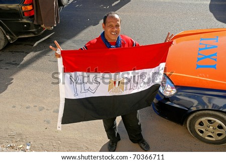 HURGHADA, EGYPT - FEBRUARY 02: Unidentified protesters demonstrate on the streets of Hurghada, Egypt on February 02, 2011. These are pro Mubarak demonstrators showing support for the Egyptian President - stock photo
