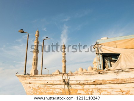 Hurghada. Egypt. Old fishing boat at sunset in Hurghada, Egypt. Pier in Hurghada. Egypt.  #1211110249