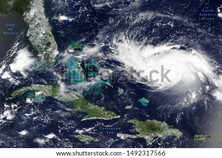 Hurricane Dorian in the Carribean Sea on its way to US mainland in August 2019 - Elements of this image furnished by NASA #1492317566