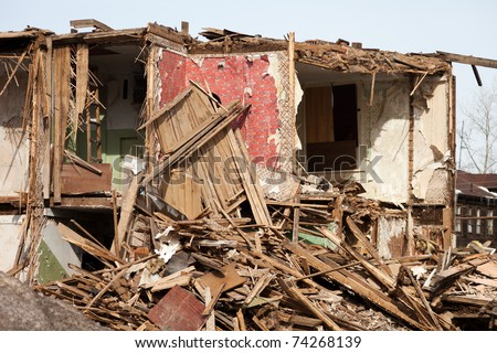 Hurricane earthquake disaster damage ruined house