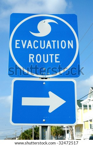 Hurricane evacuation route sign with arrow