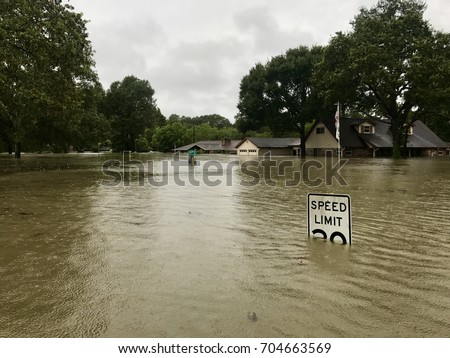 Hurricane Harvey 2017, flooding in Spring Texas, a couple miles north of Houston. Speed limit sign almost completely submerged. #704663569