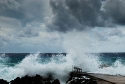 Hurricane Irma as she passes through the Caribbean. This shot was taken from the coastline of Grand Cayman where the stormy conditions created a violent ocean.
