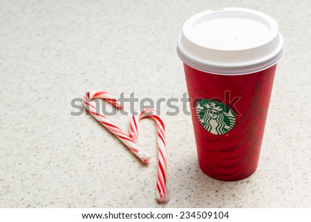Hurricane Utah - November 29 : photo of a holiday Starbucks cup with stripped candy canes on a counter, November 29 2014 in Hurricane, Utah