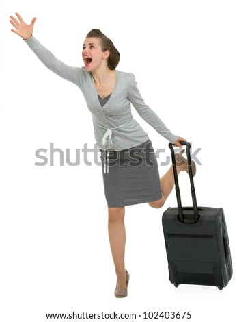 Hurry traveling woman with suitcase