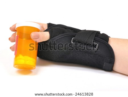 Hurt wrist with brace holding pill bottle