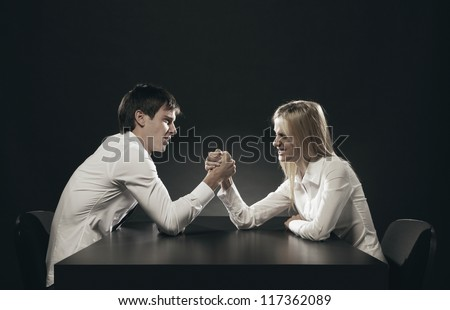 husband and wife Arm Wrestling