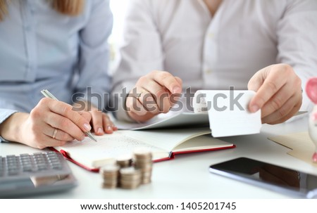 Husband and wife check purchases for deducting tax credits. Online tax form concept.