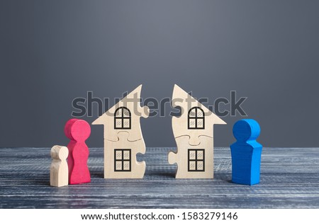 Husband and wife divide a house in a divorce process. Disputes over division of real estate and property between former spouses. Protection of rights and interests, justice. Conflict resolution