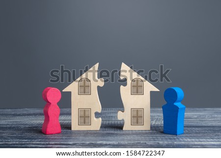 Husband and wife divide a house in a divorce process. Fair marital property division Agreement. Conflict resolution, legal services assistance. rights Infringement. Protection interests. Legality