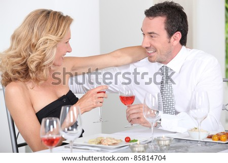 husband and wife enjoying romantic meal