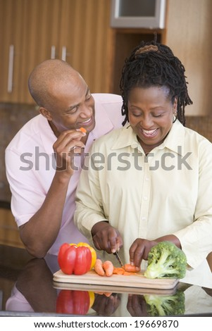 Husband And Wife Preparing A meal,mealtime Together - stock photo