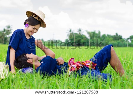 Husband and wife Thai farmers in the rice field - stock photo