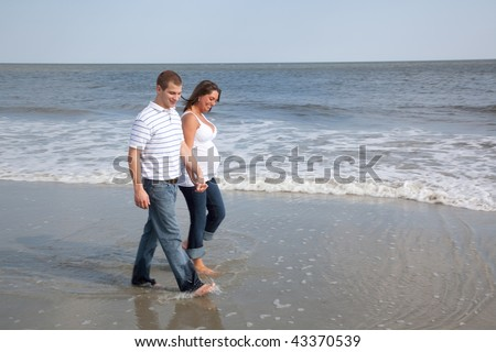 Husband And Wife Walk On Beach Holding Hands Stock Photo ...