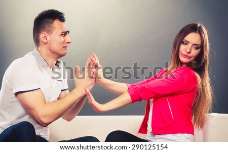 Husband apologizing wife. Unhappy, upset, angry, mad woman refuses apology. Boyfriend trying to convince girlfriend. Man asking for forgivness. Conflicted couple. Relationship problem.