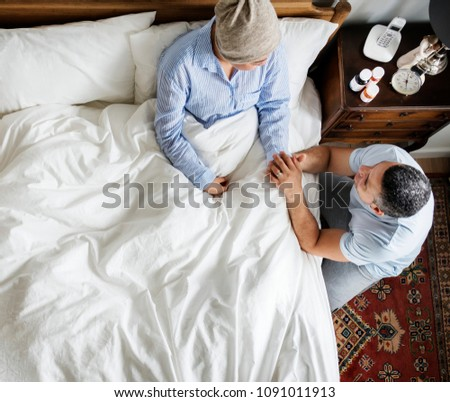 Husband cheering up cancer wife